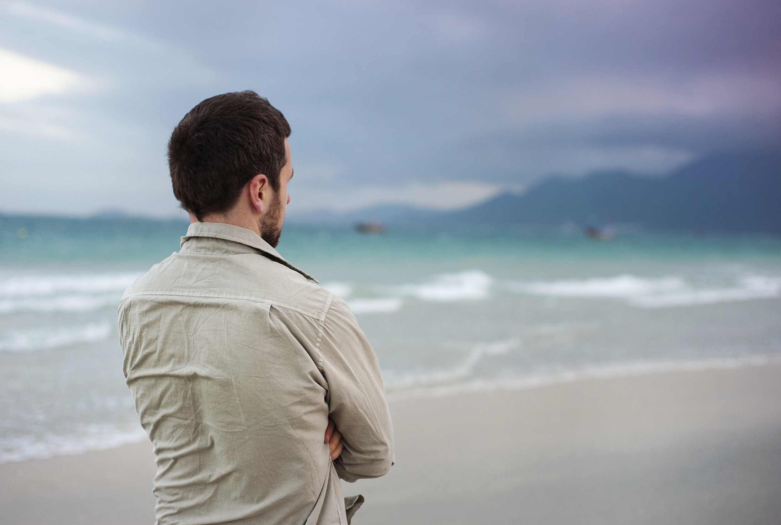 graphicstock-handsome-young-caucasian-man-walking-alone-on-the-beach_BCXufajhWZ.jpg