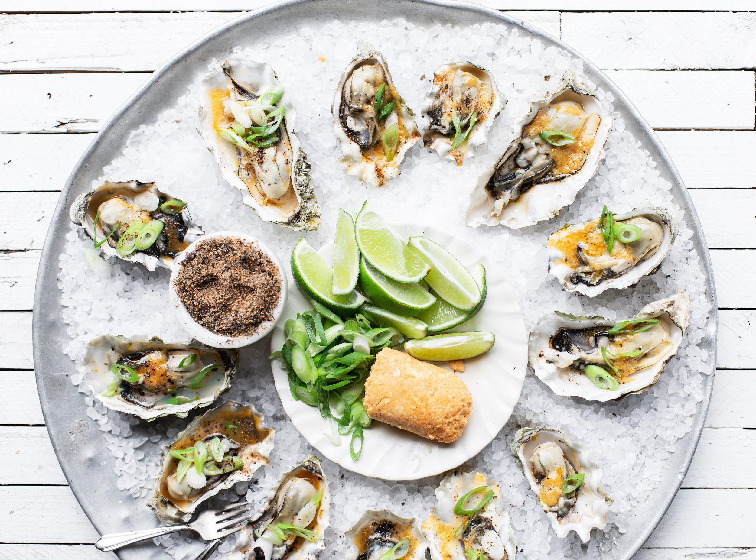 49f3bb3e-71dd-4b13-aeba-77ac58ad814d-Smoked+Oysters+with+Spicy+Miso+Butter12.jpg