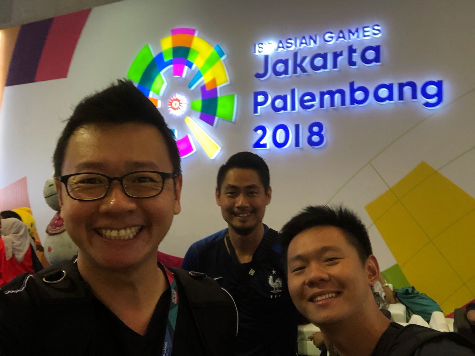 With friends from the local media at the 2018 Asian Games, Jakarta, Indonesia.