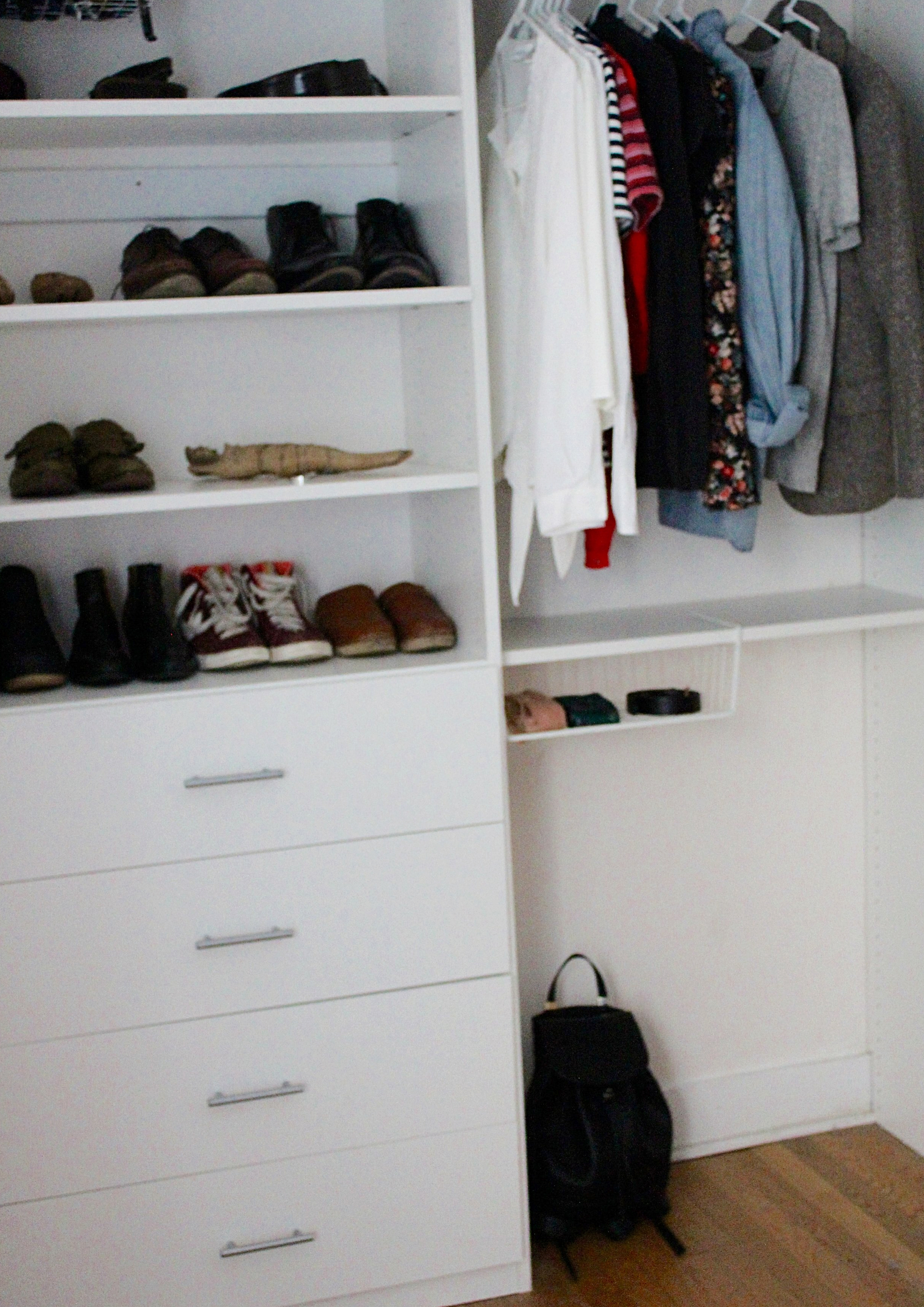 My (almost) finished closet. (That's my husband's clutter up top!)