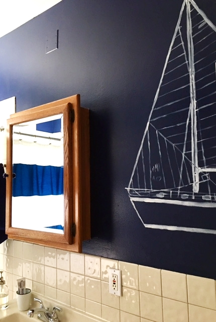 Kelsey's dad runs a marina and she's been sailing since she was a babe. The largesailboat is hand-stenciled.