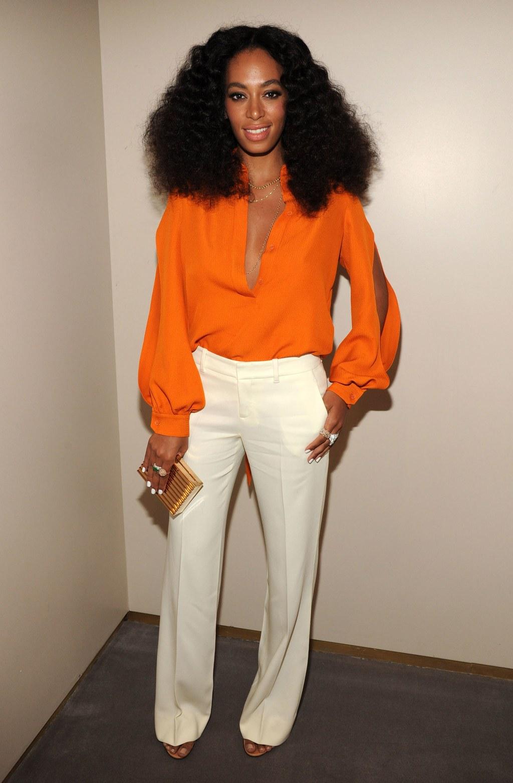fashion-2014-06-solange-white-pants-orange-suit-chime-for-change-main.jpg