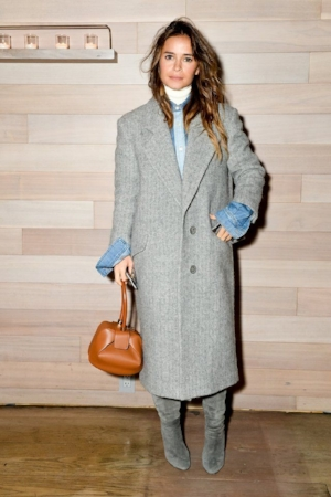 That purse is in every shot! It's  Gabriela Hearst and it's got a waitlist .