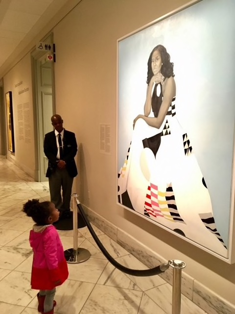 Parker Curry, 2, stands in awe of the new National Portrait Gallery painting of Michelle Obama.