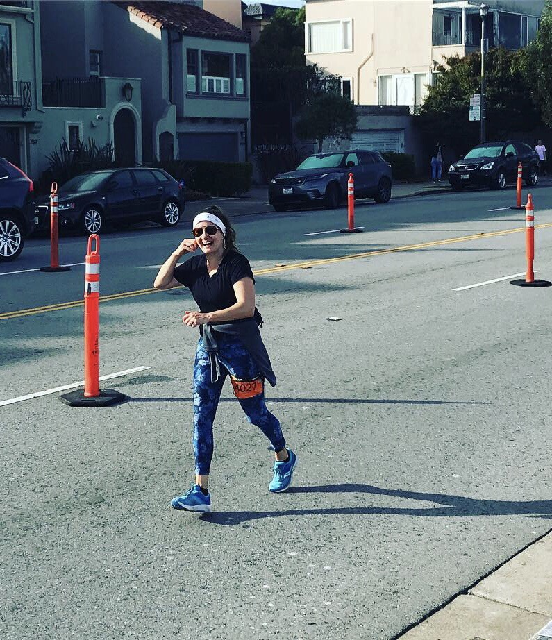 """Vanessa running the Golden Gate Half Marathon 11/4/19. """"This was mile 12.5 and I could barely lift my legs."""""""