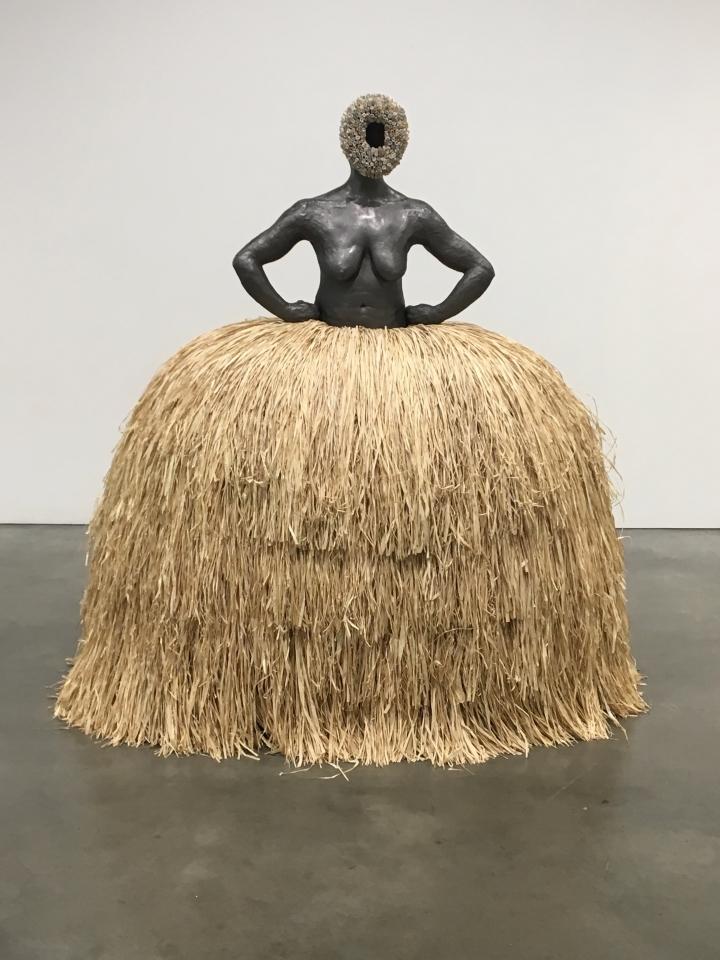 "Simone Leigh, ""No Face (Pannier)"" (2018), terracotta, graphite, salt-fired porcelain, steel, raffia"