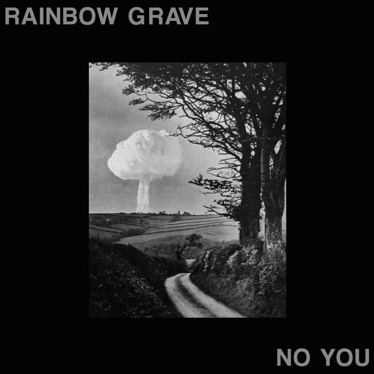 """""""No You"""" by Rainbow Grave - Doom, punk, psych, sludge, negativity, Napalm Death - ok, let's be honest, you had me at doom. But, those are just a few maggots sunken into the corpse that Rainbow Graves has to offer on their debut full-length, No You. You talking to me? No, YOU! Me? Yeah! SHIT. Well, here in the crypt we are always on a rabid search and destroy mission for those providing soundtrack to blood-drenched iron pumping and solemn vampiric mediative therapy sessions, and there is none other candidate this time around than Rainbow Grave's No You. Constructed upon the graves from founding members of the aforementioned grind lords Napalm Death; as well as, but not limited to, Doom, Scorn, and the mighty; Sore Throat. Although thee be warned, I would be weary to deem these boisterous Birmingham-based bastards that of a """"supergroup"""" , because there is hardly anything """"super"""" about them at all. Rather, their strength & powers align with that of the anti-super; the recess, the void, the down, the villain. Anti-hero depressive punk that's certainly not afraid of a guitar tone found only thriving in the oozing sewers of London, spewing vile lyrics with a vocal style not too far off from what you could imagine Jack The Ripper would channel; speaking of the streets of London. And spewing. And ripping. And darkness. Anyway, the utterly filthy tone and themes found within this record are repeatedly inflicting physical and psychological damage upon the listener and then delivered again packaged in a murkier guises, as the psychedelic loop aspect and primal rhythm patterns always make a triumphant and vomit-inducing return… and seem to not let up until the final droning feedback subsides on the concluding track. Sounds like a delightful listening experience, no?TEN MILLION TONS OF SHIT. Yes, the subtle opening track more than sets the tone - twice - and will leave you writhing in the loathsome doom and absolute hatred painted so vividly on this track. """"I hate your car, I ha"""