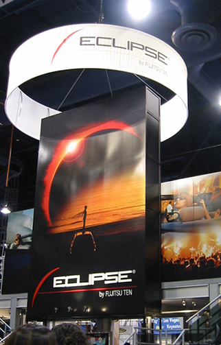 Trade show booth with round hanging banner