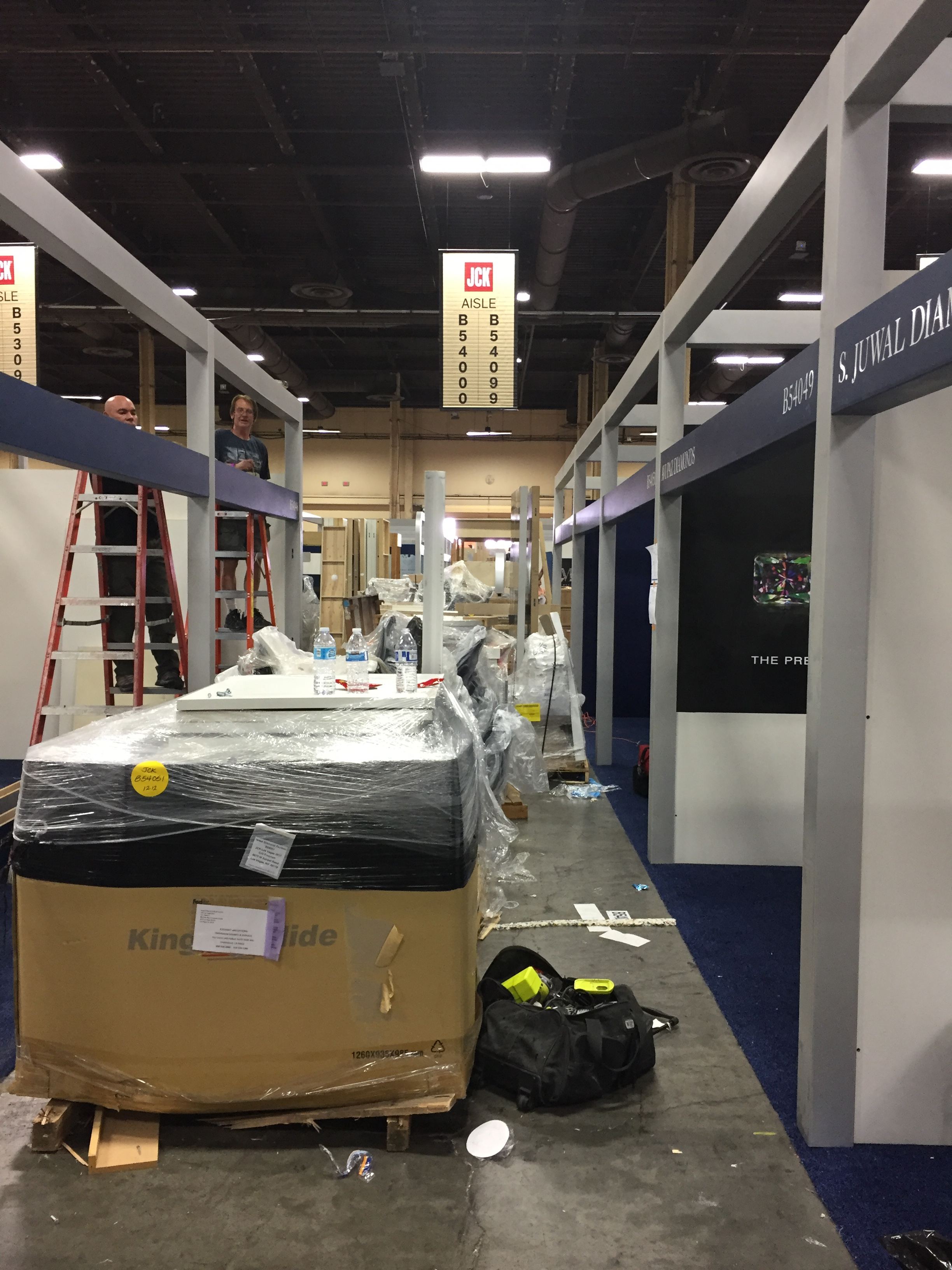Reviewing the exhibit floor for carpet and electrical before installing booth