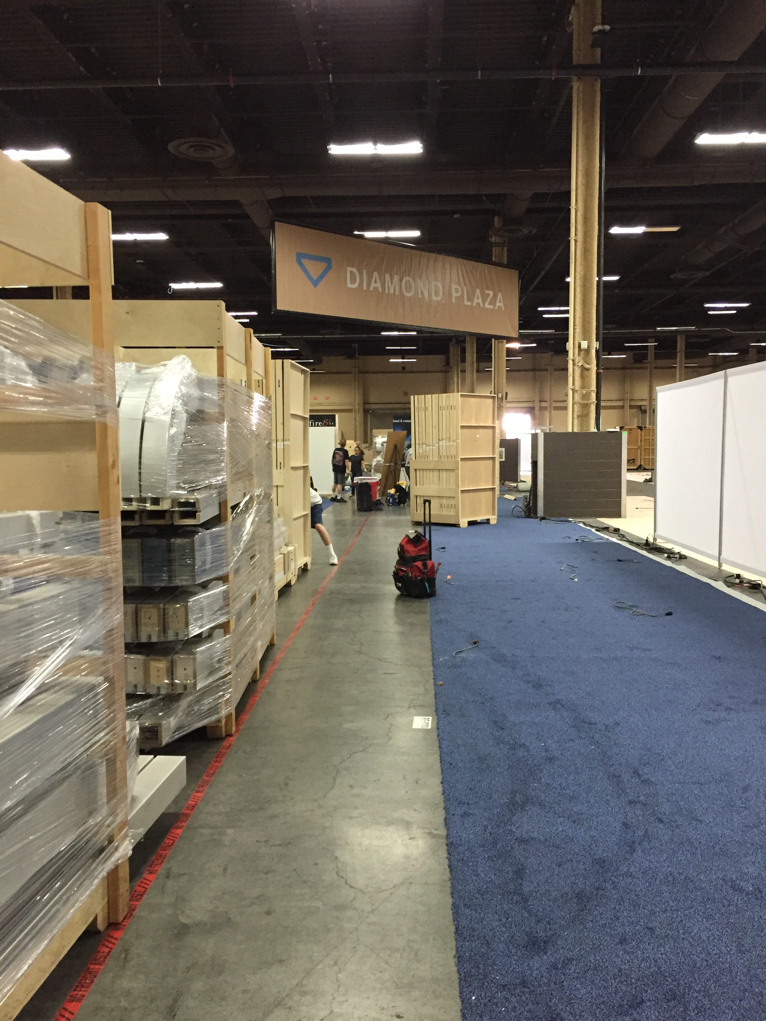 Beginning stages of installing a trade show booth