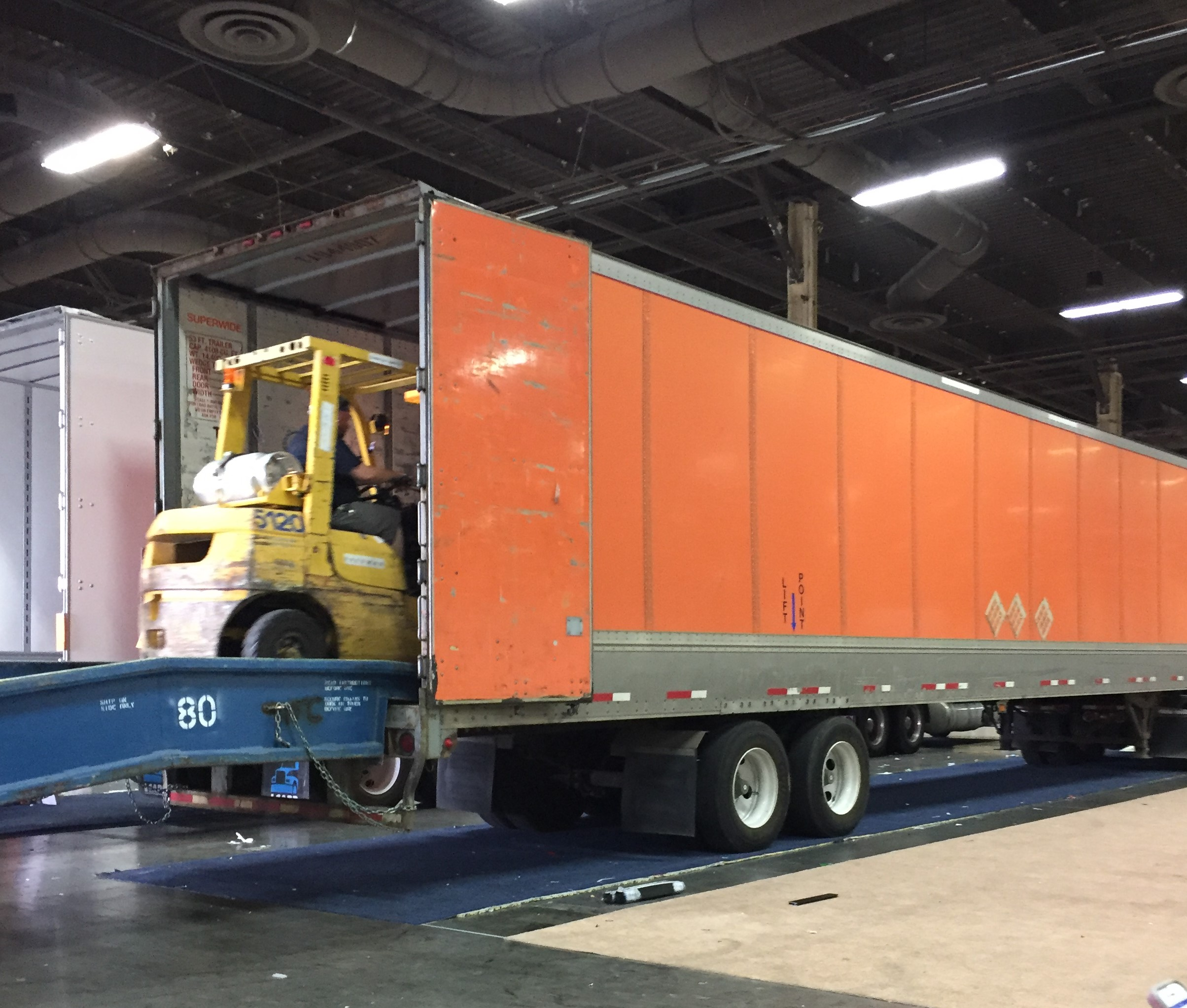 Loading the truck readying the booth for the next trade show or storage