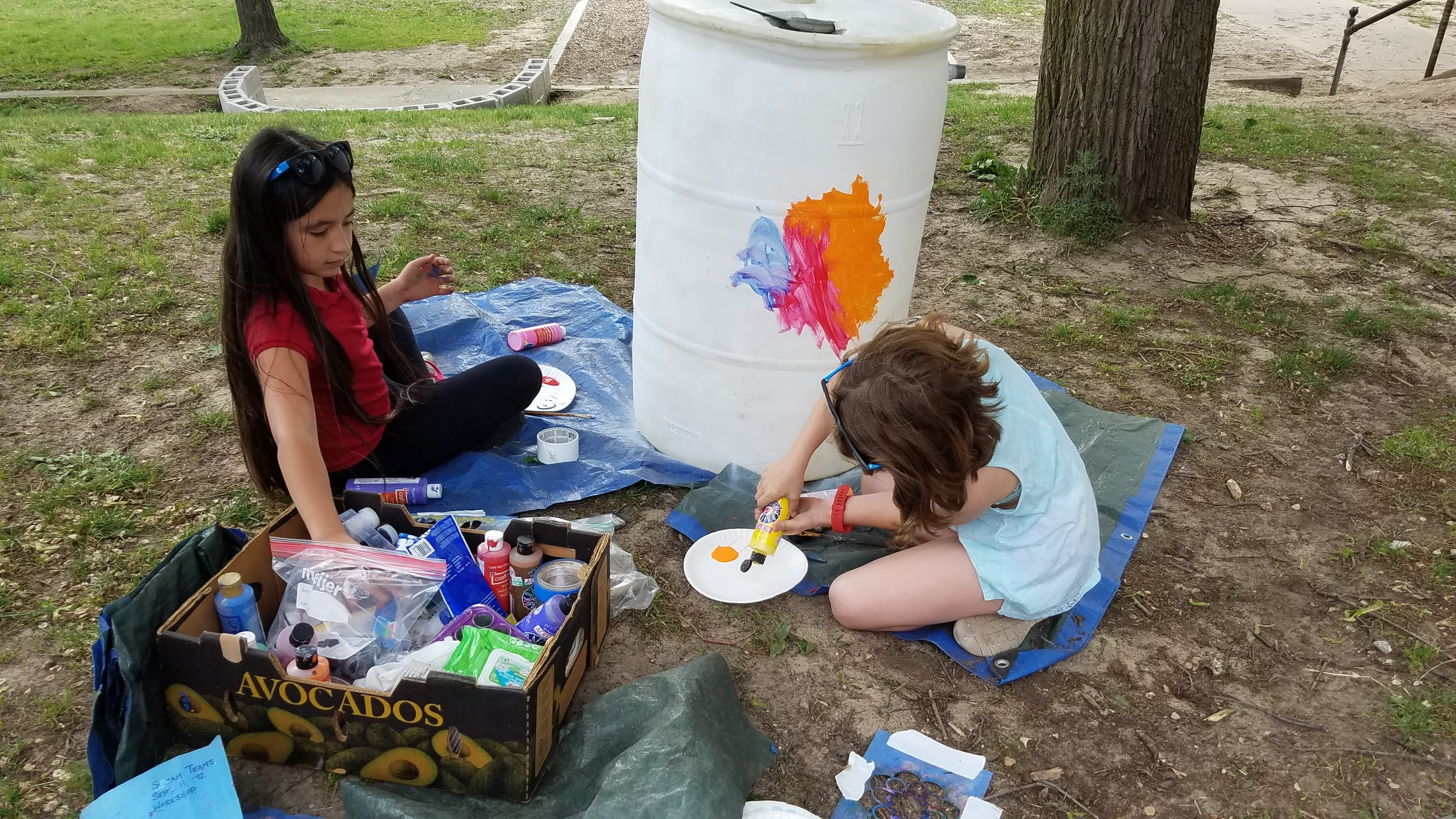 North Park Montessori Students Painting Rainbarrels at Workshop