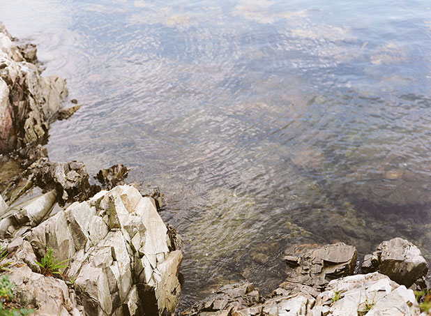 This is a photo of the water and rocky coast in New England, shot on color film.