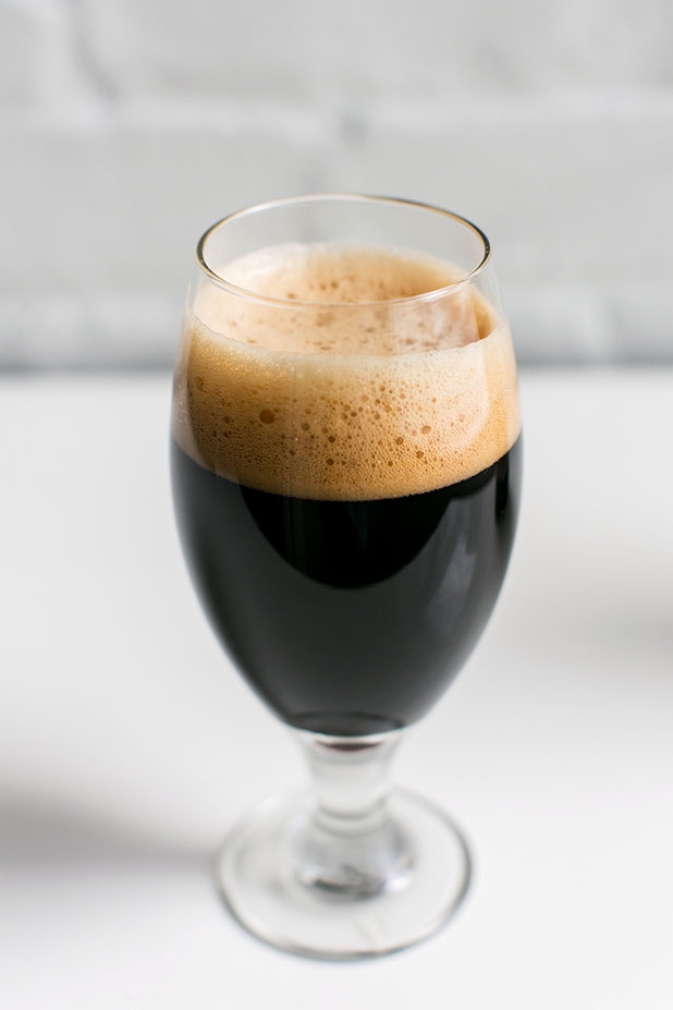Stout beer photo with creamy head and white background