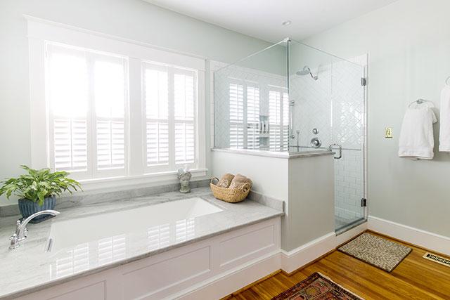 Updated bathroom by RIC Design Build in Richmond, Virginia - Sarah Der