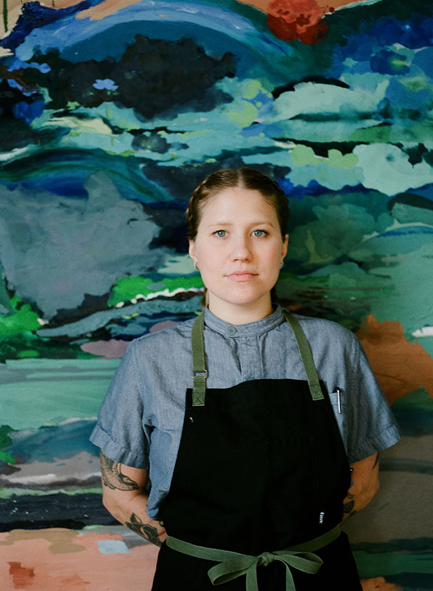 Olivia Wilson, Richmond pastry chef, in front of painting at Chairlift