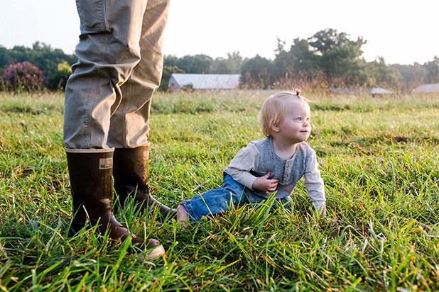Little boy and wellie boots on farm - Sarah Der