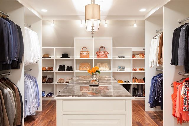 Who would bother actually going out when getting dressed in a closet like this!  A new layout and custom built-ins maximizes storage options.  Lighting: @arteriorshome 📸: @emilyobrienphoto_design  #walkincloset #beforeandafterdecor #builtinshelves #dreamcloset