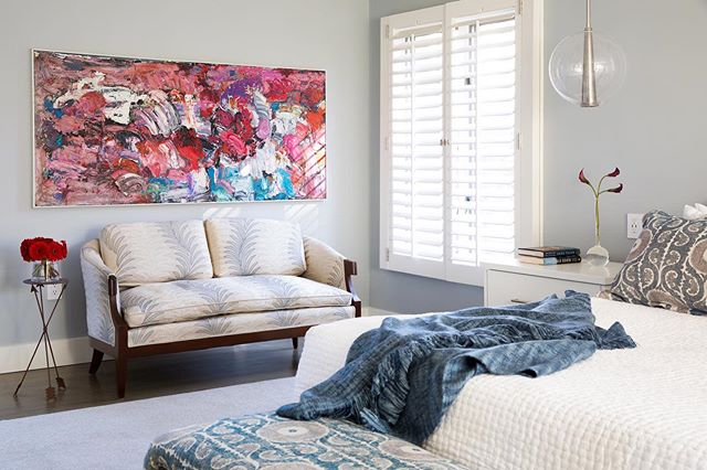 It's great when you can build a room around a piece of art that means something to you!The more neutral details of this room really let the painting POP!  Art: @sonya.rapoport  Loveseat, pillows, and Bench custom re-upholstered selections by @mmoharedesigns - fabrics by @zimmans  #dreambedroom #popofcolor #customupholstery