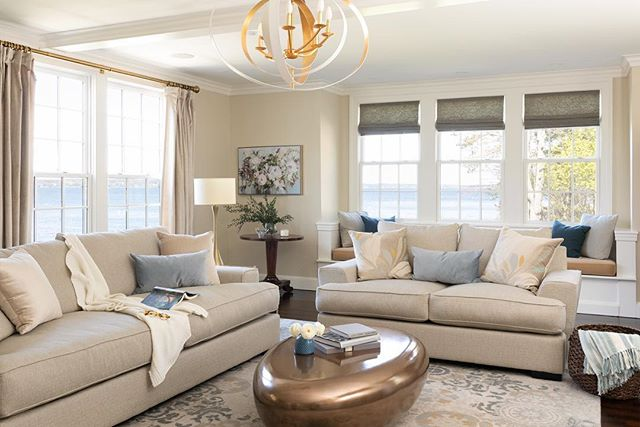 I'm a huge fan of living rooms that are on the more casual side so you ACTUALLY want to spend time there! And boy would I like to spend the day in here.  Swipe for a shocking before!  Coffee table: @mgbwhome  Chandelier:  @gabbydecor  Pillows: @roomandboard @galbraithandpaul  Rug: @potterybarn  Window Hardware: @restoration.hardware  Photos: @emilyobrienphoto_design  #livingroomdecor #livingroom #seasidedecor #beforeandafterdesign #coastaldecor #neutrallivingroom #architecturedesign #blueaccents #newenglandhome #newenglanddesigner
