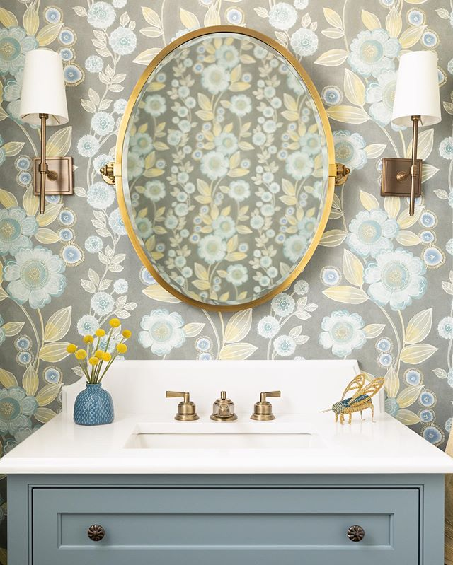 Powder rooms are such opportunities to have some fun!  I love how the gold tones of this wallpaper compliment the brass fixtures.  Custom Vanity: MMO Designs Faucets, Mirror, and Sconces: @potterybarn  Custom Countertop: @italmarblegranite  Wallpaper: @brewsterhome  Contractor: @windhillbuilders  Photo: @emilyobrienphoto_design  #powderroom #powderroomdesign #powderroomwallpaper #bathroomdesign #wallpapers #bathroom #interiordesign