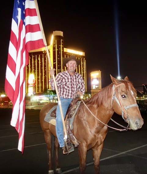 RAFAEL SARABIA SHOWED UP ON THE GRIEF-STRICKEN STRIP WITH HIS HORSE AND OLD GLORY.PHOTO: NORM CLARKE.