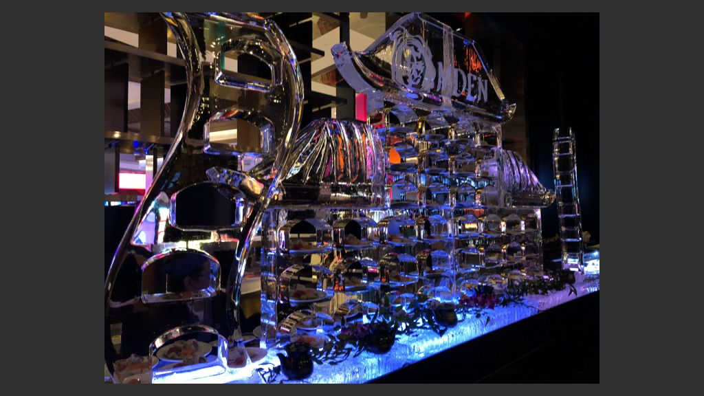 """Palms party: Sushi was served through carved-out slots in this massive ice sculpture at the Camden Lounge, one of the new additions in the Palms' first phase of a $620 million renovation billed """"From Dust to Gold."""" Photo: Norm Clarke"""