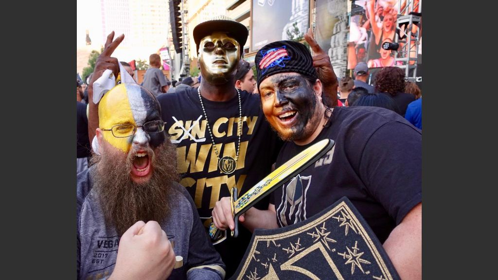 TRI-COLORED GOLDEN KNIGHTS FANS FROM LEFT: CHARLES LYNCH AND RON CARPENTER, RIGHT. MAN IN CENTER UNIDENTIFIED. Photo: Norm Clarke