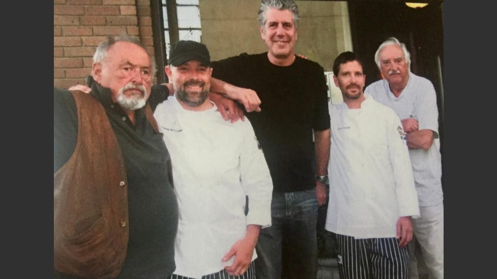 Anthony Bourdain with author Jim Harrison, 2nd Street Bistro chefs and artist Russ Chatham on May 21, 2009.