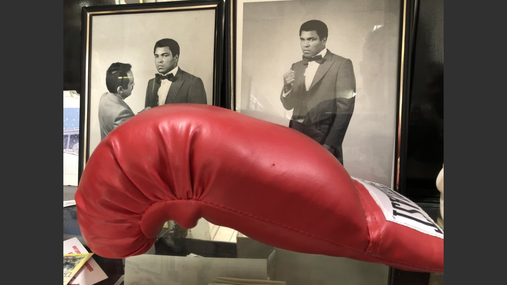 Photos of Muhammad Ali in a suit designed by Yaghi.