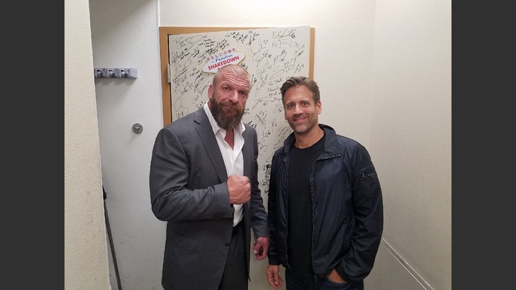 """WWE star Triple H with ESPN personality and boxing analyst Max Kellerman at Scotch 80 Prime, adding their signatures to executive chef Barry Dakake's """"Shakedown Room"""" collection. (Courtesy photo)"""