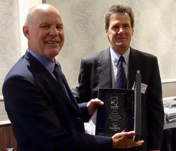 Tim Dahlberg, longtime Las Vegas-based Associated Press sportswriter/columnist, was inducted into the Nevada Press Association's Hall of Fameon Saturdayat Palace Stationon Saturday. Presenting the award to Dahlberg was Barry Smith, NPA executive director. Photo: Norm Clarke