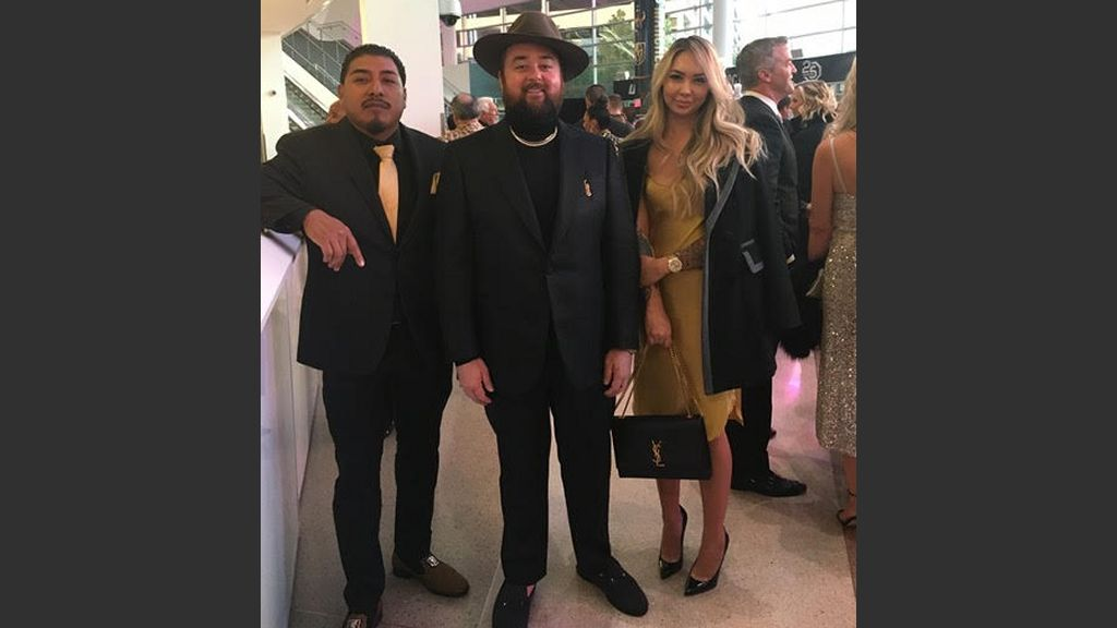 """Austin """"Chumlee"""" Russell, center, with his friend, Edgar Alavez and fiance Olivia Rademann at the Grant a Gift gala at T-Mobile on Thursday. Photo: Courtesy"""