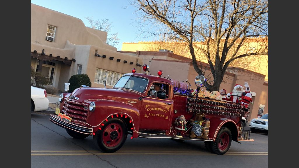 Santa's reindeer weren't in shape so he arrived at the Santa Fe Plaza by fire truck.