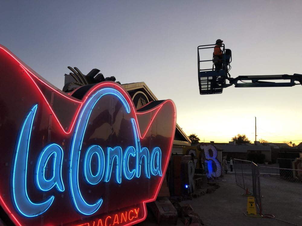 At dawn on Monday, a worker prepares for the arrival of one of the six pieces of the Hard Rock Cafe guitar at its new home —the Neon Museum. The La Concha sign was part of the motel that opened on Las Vegas Boulevard in 1961 and closed in 2004. Guests included Muhammad Ali, Ronald Reagan, Ann-Margret and Flip Wilson.