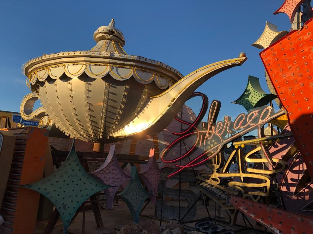 Early light reflects off the Aladdin's genie lamp on Monday. The Liberace sign pays homage to the highest paid entertainer in the world. The Riviera lured him to Las Vegas a whopping $50,000 per week salary in 1955.