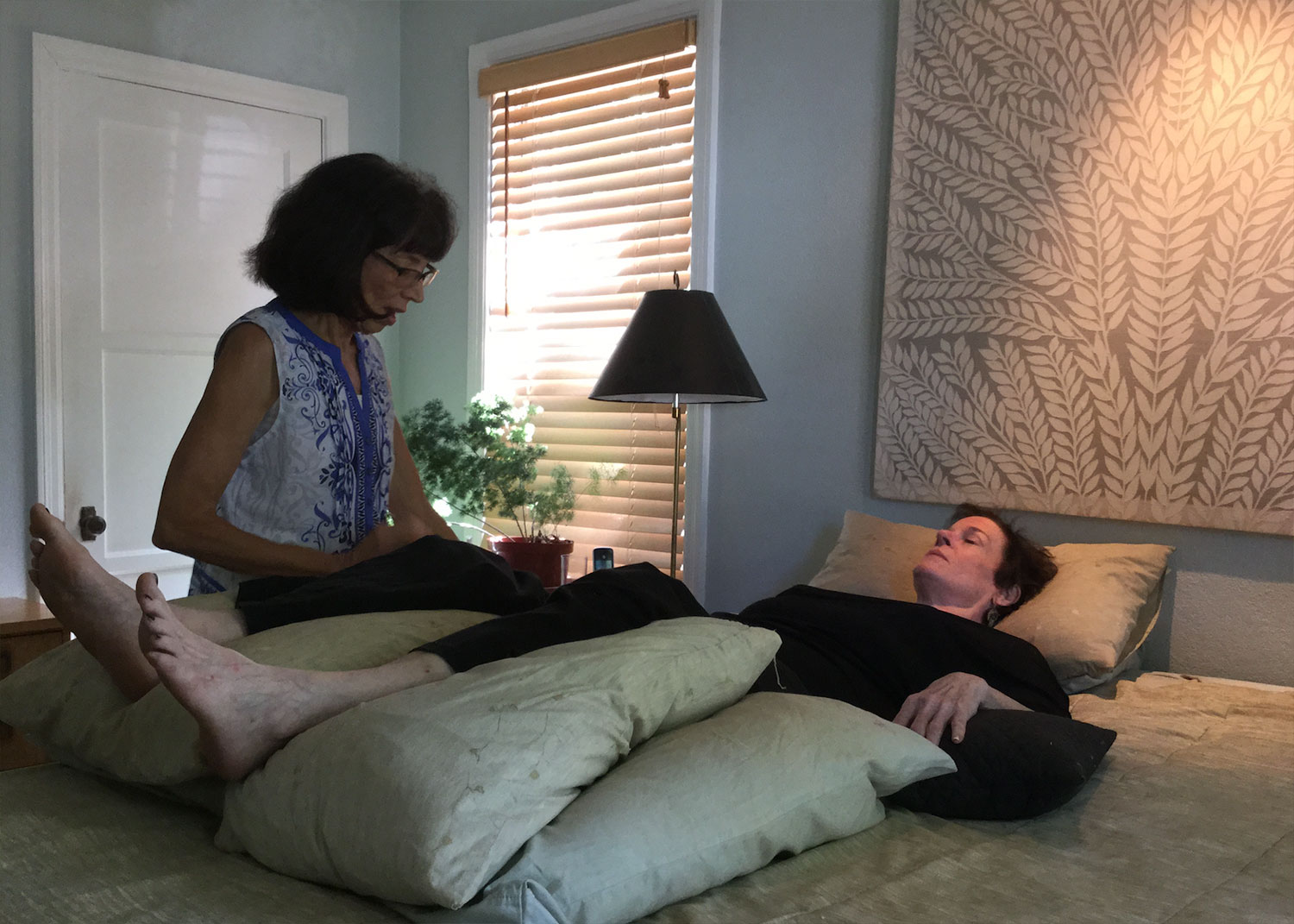A client in yoga nidra, guided relaxation.