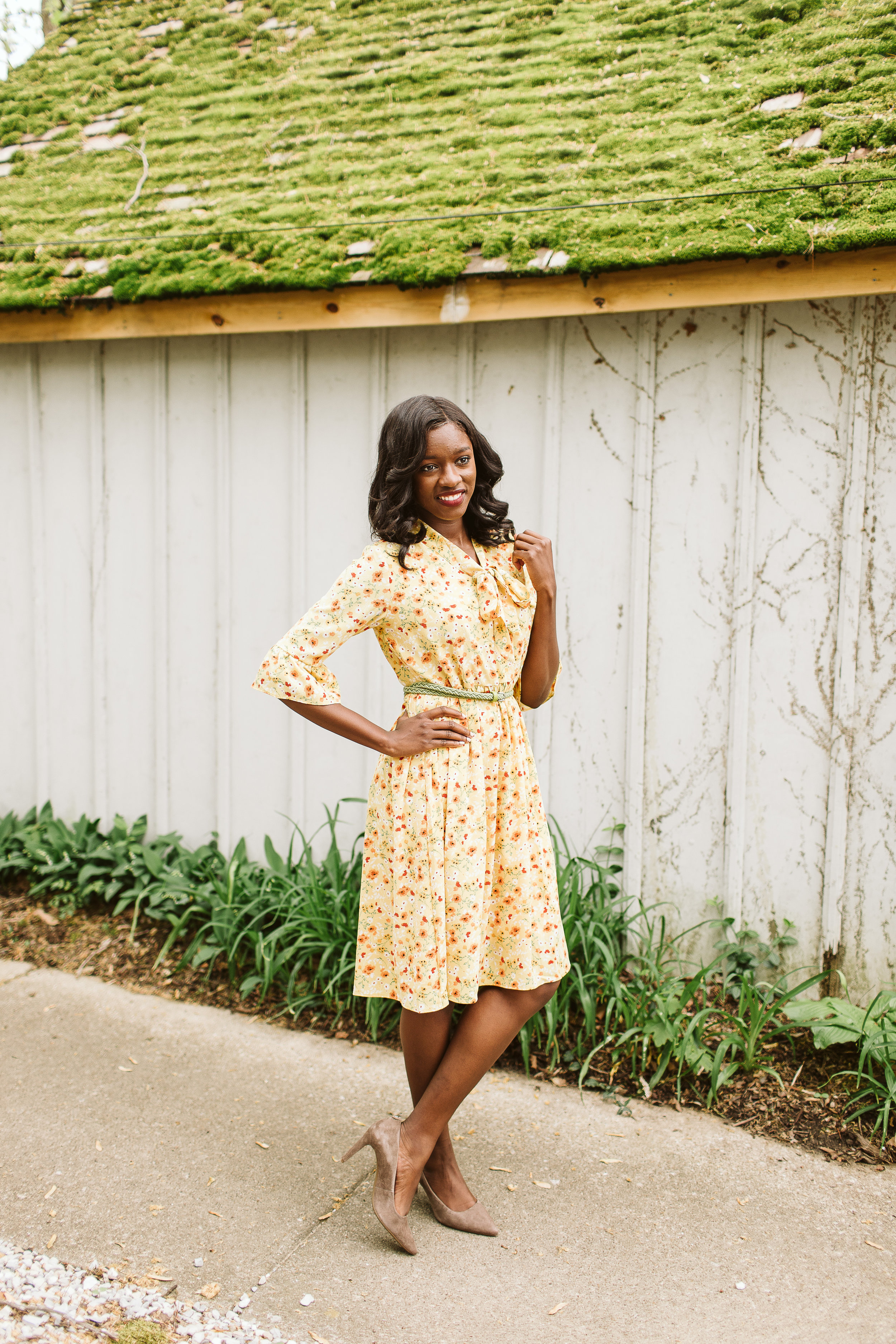 Cherelle wears the  Mustard Babydoll Dress . Available at Simple Extravagance for $35.