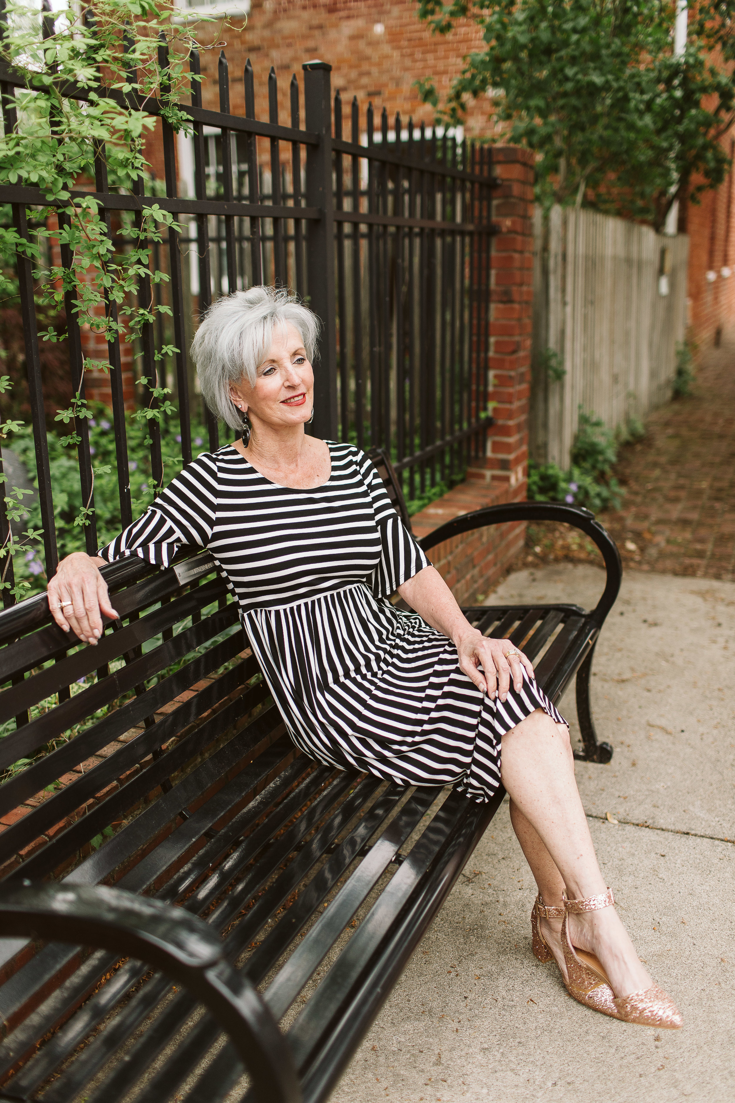 Vicki wears the  Ruffle Sleeve Striped Dress from Simple Extravagance Boutique. $38.