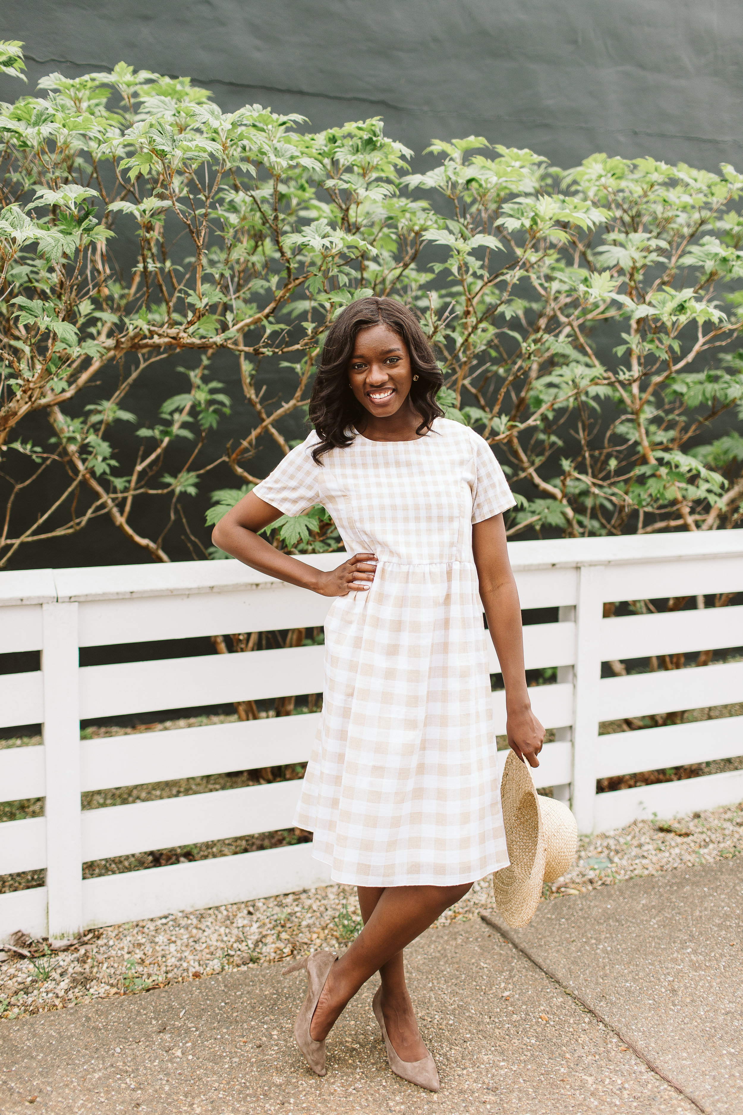 Cherelle wears the  Taupe Gingham Dress from Simple Extravagance Boutique. $48.