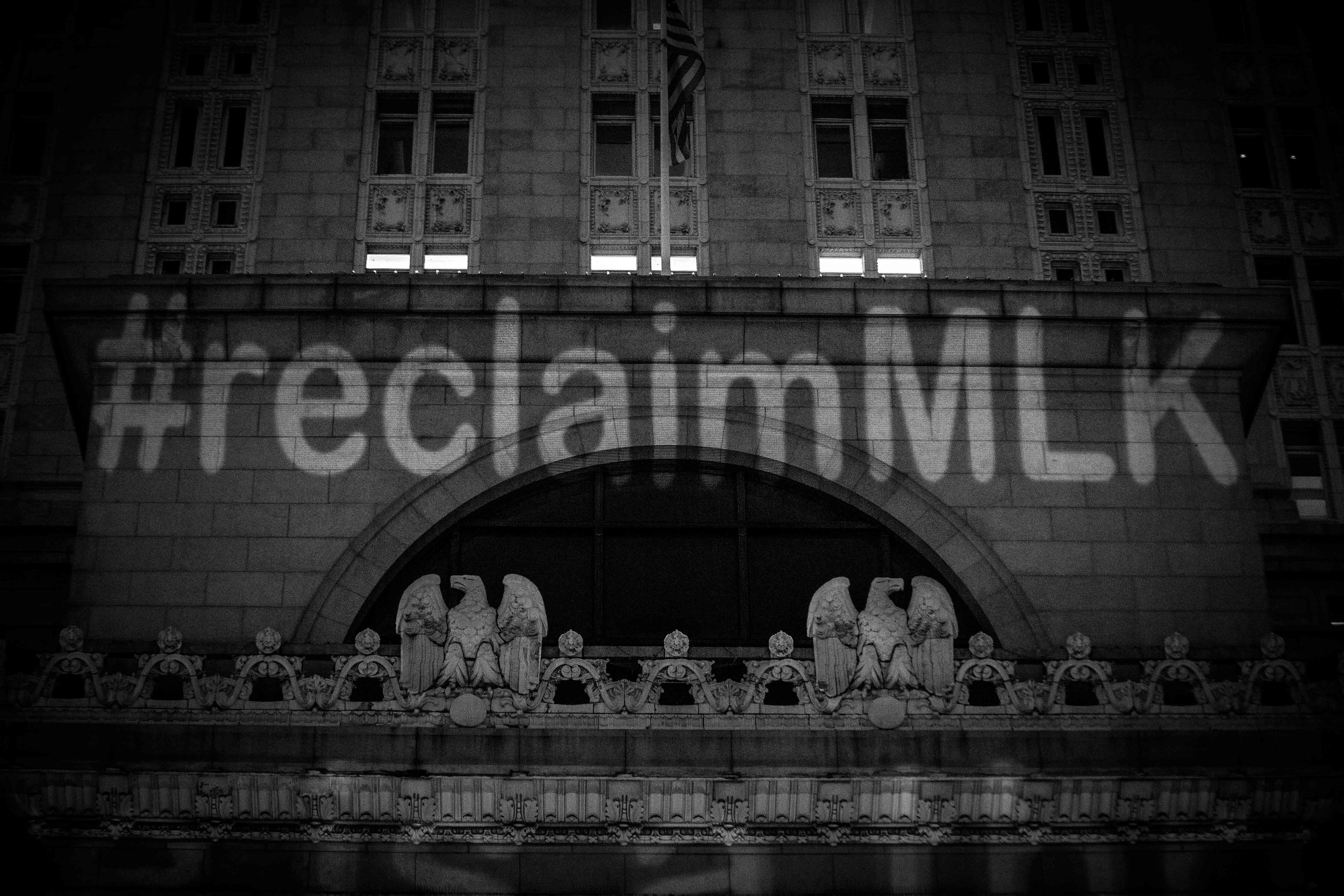 #ReclaimMLK projected onto Oakland City Hall