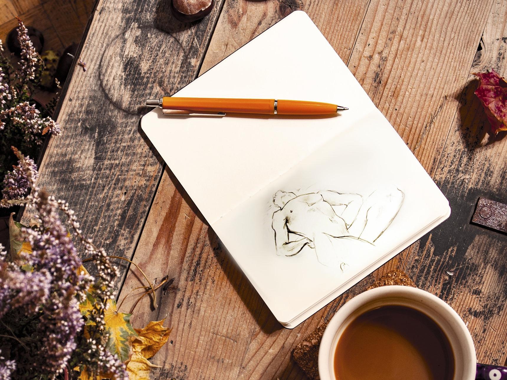 Sketchbook with sketch of man.jpg