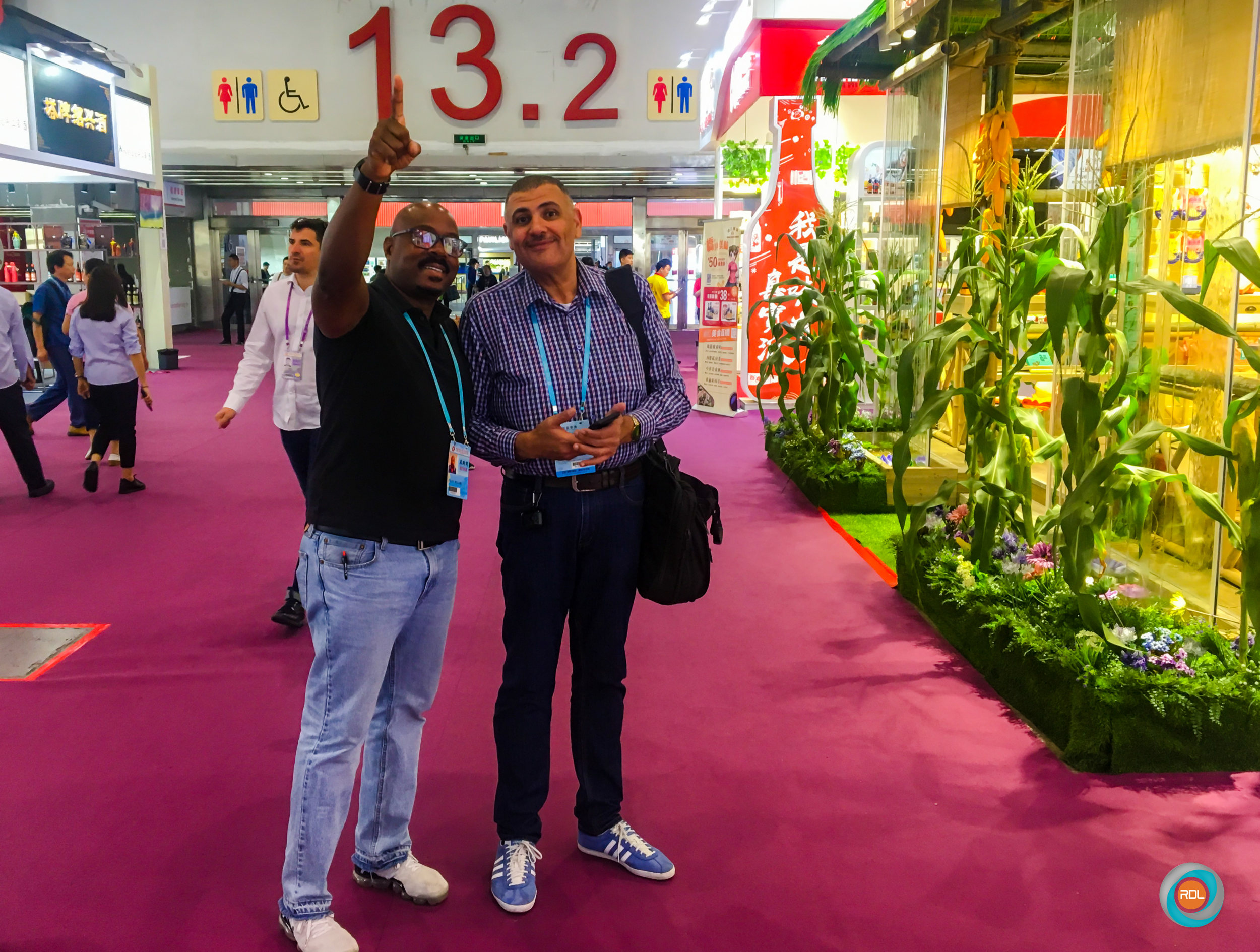 RDL's Logistics and Supply Chain Consultant Collis Williams, interacts with a Canton Fair attendee from Egypt.