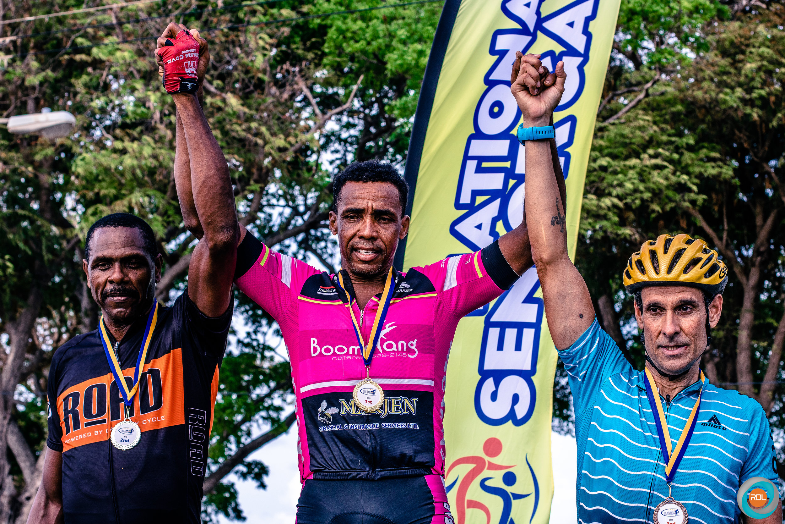 Sedwin Jones (centre) won the Masters 50+ category ahead of Gerald Bovell (left) and Wayne Edwards (right).  Download ⤓