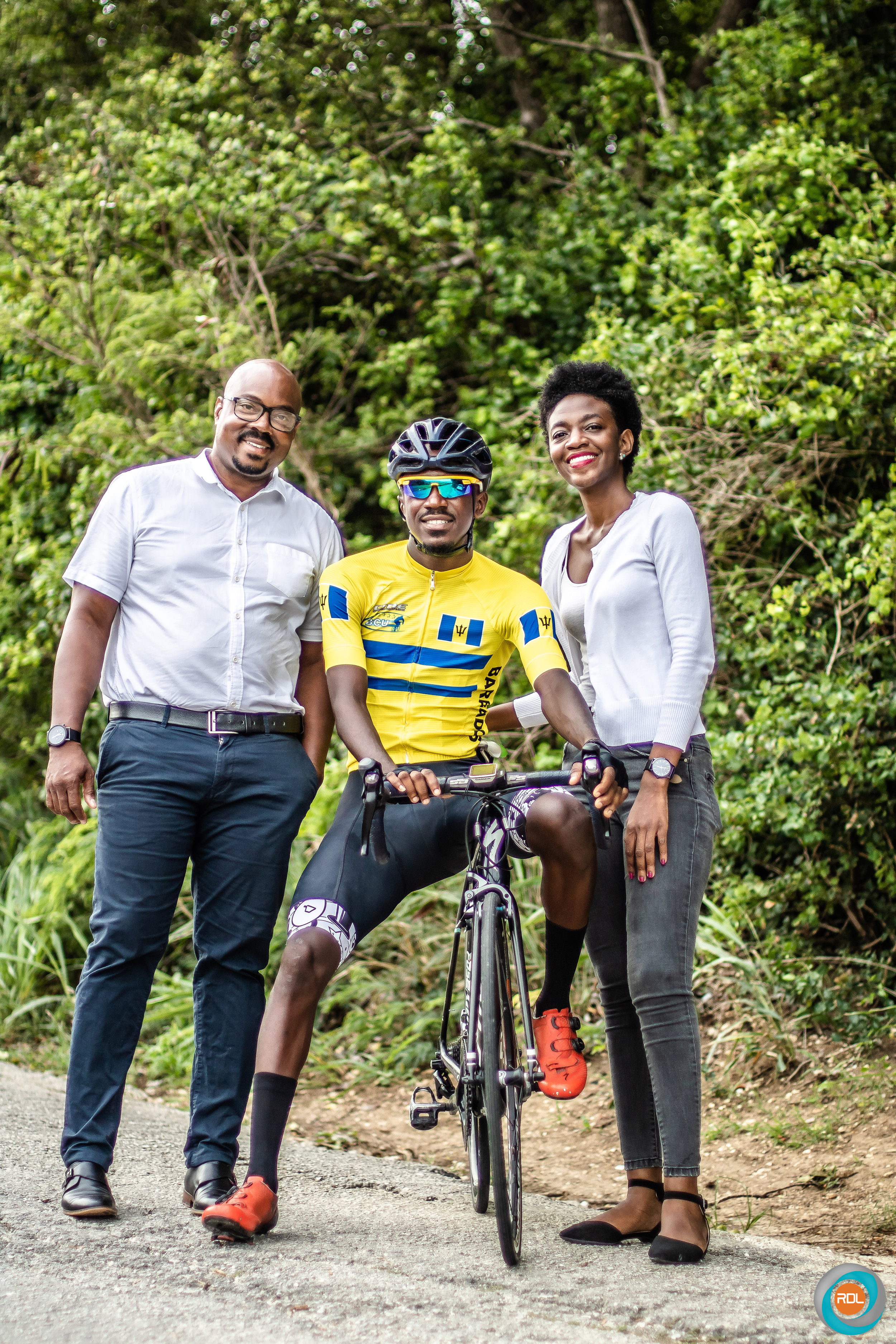 Vanderpool poses for a shot with Collis Williams, Logistics Director at RDL Eagle Trade along with his sister Cherise Vanderpool.