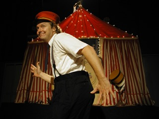 will be here to entertain all ages! This show gives everyone an opportunity to participate in an enthralling, whimsical celebration of the imagination. This show has been performed over 500 times around the globe. When Kevin opens his suitcase an entire circus emerges: tent, band, lights, the boisterous ringmaster Steve Fitzpatrick, the officious Mervin Merkle, the incredible Bumbilini Family, the Magician to the Stars Clyde Zerbini, and Keefer–an innocent trying to runaway and join the circus. However, the most important performers emerge from the audience.  Free as always.