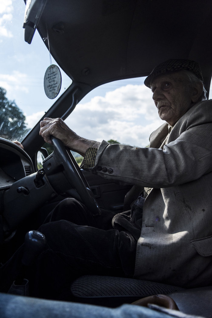 Taid driving the pickup watching over his flock at the age of 95.
