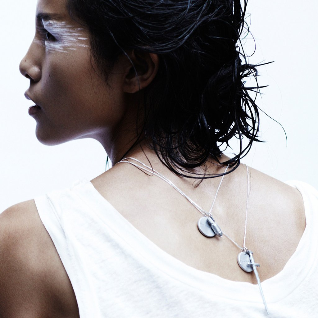 "For the Peacemaker - This ""Love is the Bomb"" necklace from Article 22 is sure to make them smile. The awesome brand transforms bomb shrapnel into stunning jewelry with a positive message. Each purchase helps de-mine land in Laos and supports traditional Laotian artisans. Talk about turning lemons into lemonade."