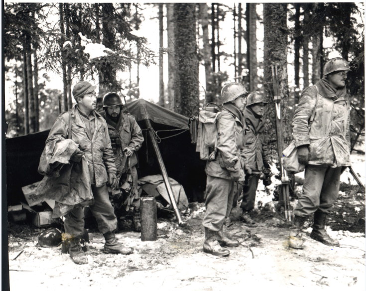 Vosges Forest, France, 11/14/1944: Bob Yorita, Shigeru Suekuni, Lefty Ichihara, Michio Takata, and Capt. Joe Hill of F Company, 2nd Bn, 442nd RCT. Their unit is holding a section of the front lines.  (Signal Corps photo.)