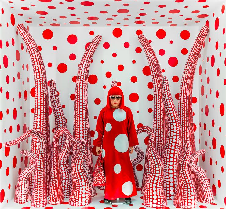 Yayoi Kusama camouflaging herself amoungst her installation